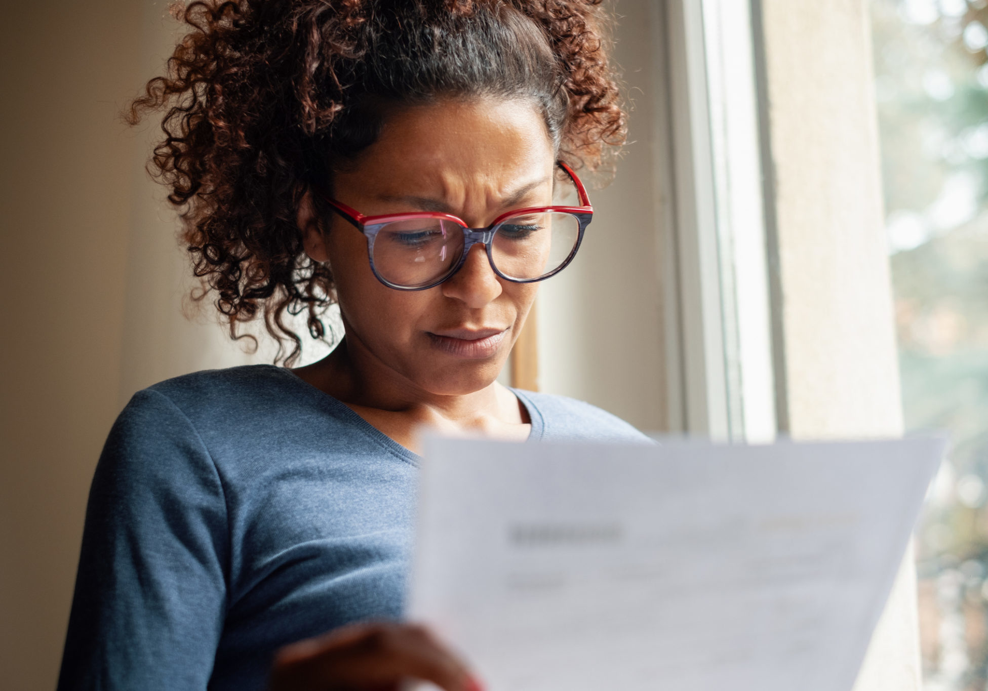 Woman worried about sheet of paper