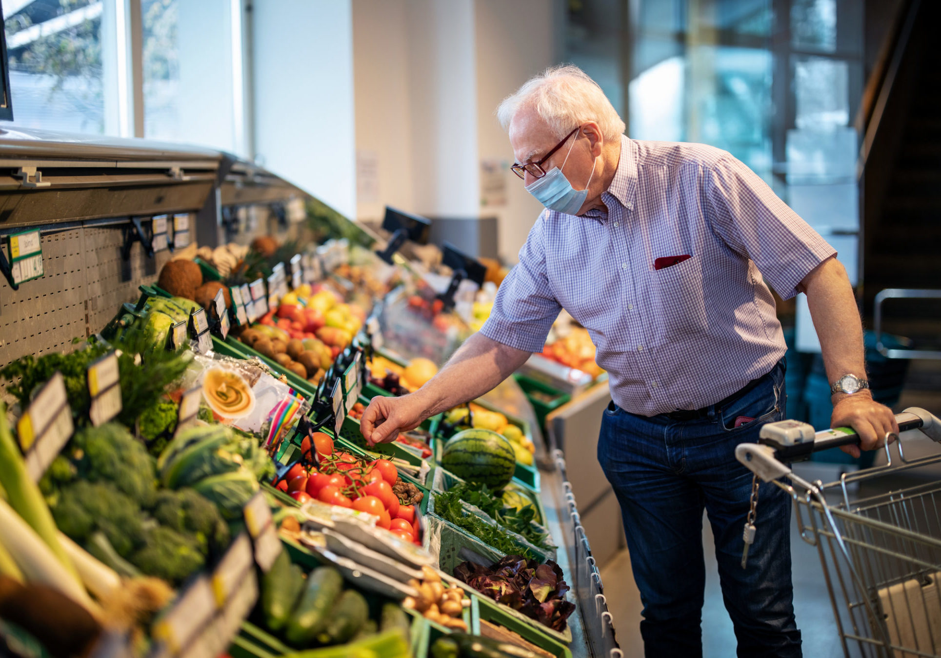 Senior Man With Face Mask Buying Vegetables In Grocery Store