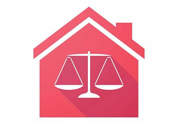 Illustration of a red house with the scales of justice in the foreground